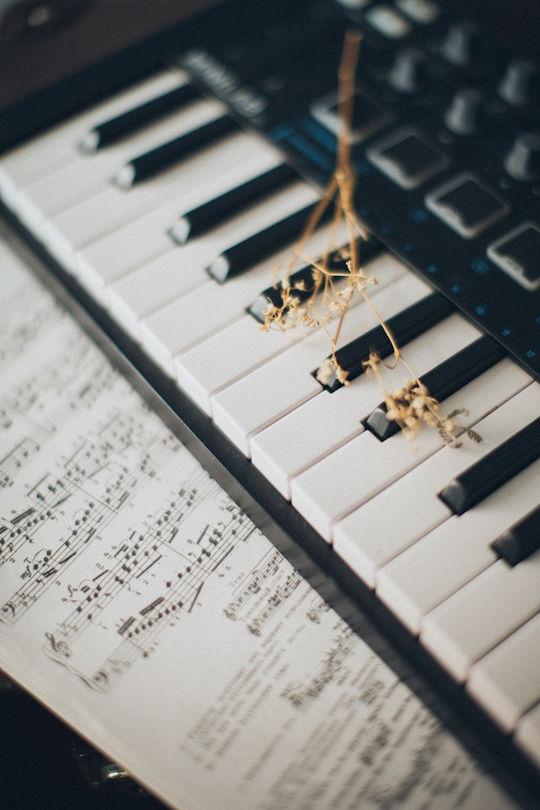 music sheets and piano